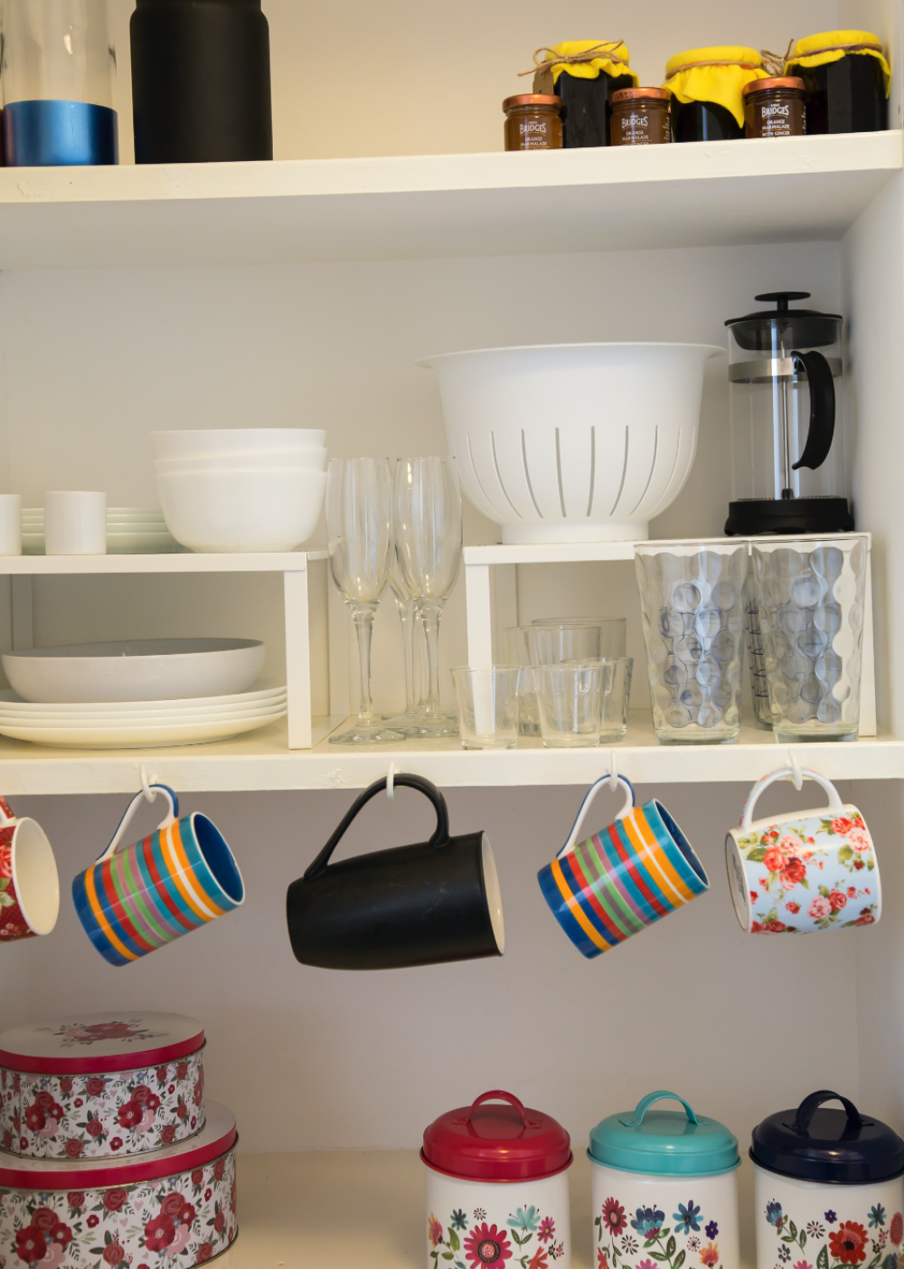The kitchen is cute and quirky, with pots and pans, cloths and utensils, a two-plate hob, cooker, microwave, fridge-freezer and brand new washer-dryer.